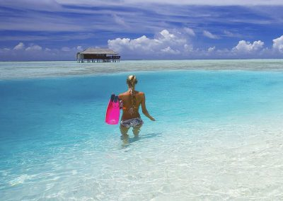 Medhufushi-Island-Resort-maldives-snorkel-clear-blue-water